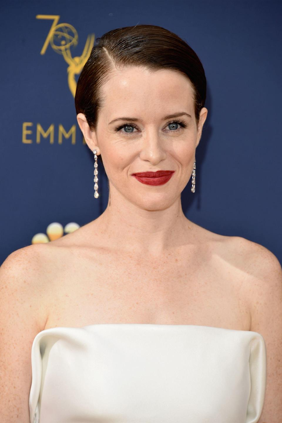 """<p>Claire Foy clearly also got the <a href=""""https://www.refinery29.com/en-us/2018/09/210191/celebrity-red-lipstick-trend-emmys-2018"""" rel=""""nofollow noopener"""" target=""""_blank"""" data-ylk=""""slk:red lipstick"""" class=""""link rapid-noclick-resp"""">red lipstick</a> memo. The actress walked the carpet in a deep crimson shade that popped against her ivory Calvin Klein gown.</p><span class=""""copyright"""">Photo: John Shearer/Getty Images.</span>"""