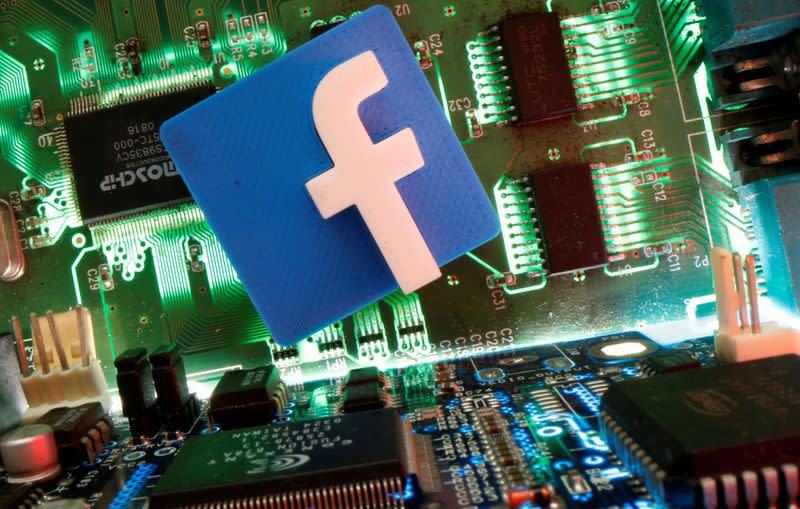 Facebook symbol is seen on a motherboard in this picture illustration