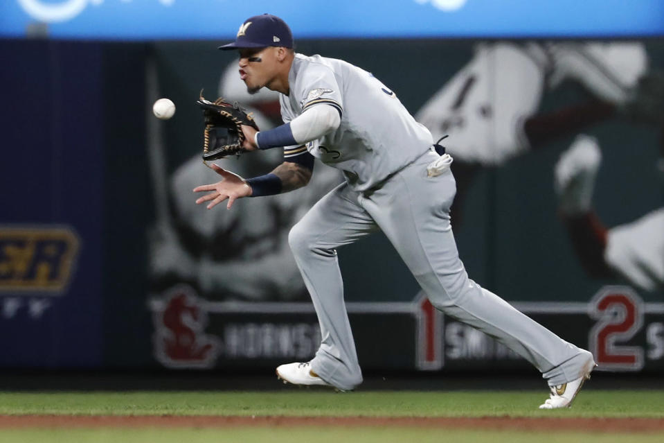 Milwaukee Brewers shortstop Orlando Arcia catches a line drive by St. Louis Cardinals' Yadier Molina to end the sixth inning of a baseball game Saturday, Sept. 14, 2019, in St. Louis. (AP Photo/Jeff Roberson)