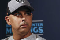 FILE - In this Dec. 9, 2019, file photo, Boston Red Sox manager Alex Cora listens to a question during the Major League Baseball winter meetings, in San Diego. Houston manager AJ Hinch and general manager Jeff Luhnow were suspended for the entire season Monday, Jan. 13, 2020, and the team was fined $5 million for sign-stealing by the team in 2017 and 2018 season. Commissioner Rob Manfred announced the discipline and strongly hinted that current Boston manager Alex Cora the Astros bench coach in 2017 will face punishment later. Manfred said Cora developed the sign-stealing system used by the Astros. (AP Photo/Gregory Bull, File)
