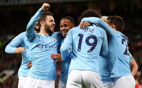 Leroy Sane of Manchester City celebrates with teammates David Silva, Bernardo Silva, Sergio Aguero and Raheem Sterling - Credit: Getty Images
