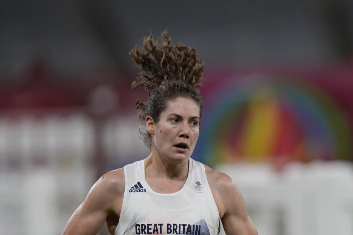 Kate French of Great Britain competes in the running and shooting portion in the women's modern pentathlon at the 2020 Summer Olympics, Friday, Aug. 6, 2021, in Tokyo, Japan. (AP Photo/Hassan Ammar)