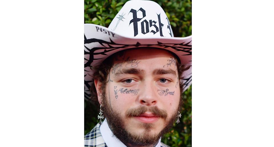"""Post Malone's """"Always Tired"""" and """"Stay Away"""" face tattoos. (Getty Images)"""