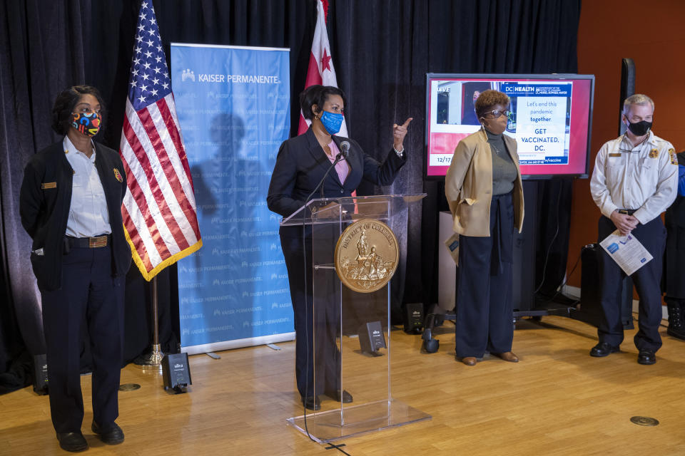 District of Columbia Mayor Muriel Bowser speaks during a news conference following an event to administer the Pfizer-BioNTech vaccine for COVID-19 to frontline workers during a vaccine event at Kaiser Permanente Capitol Hill Medical Center in Washington, Thursday, Dec. 17, 2020. (Shawn Thew/Pool via AP)