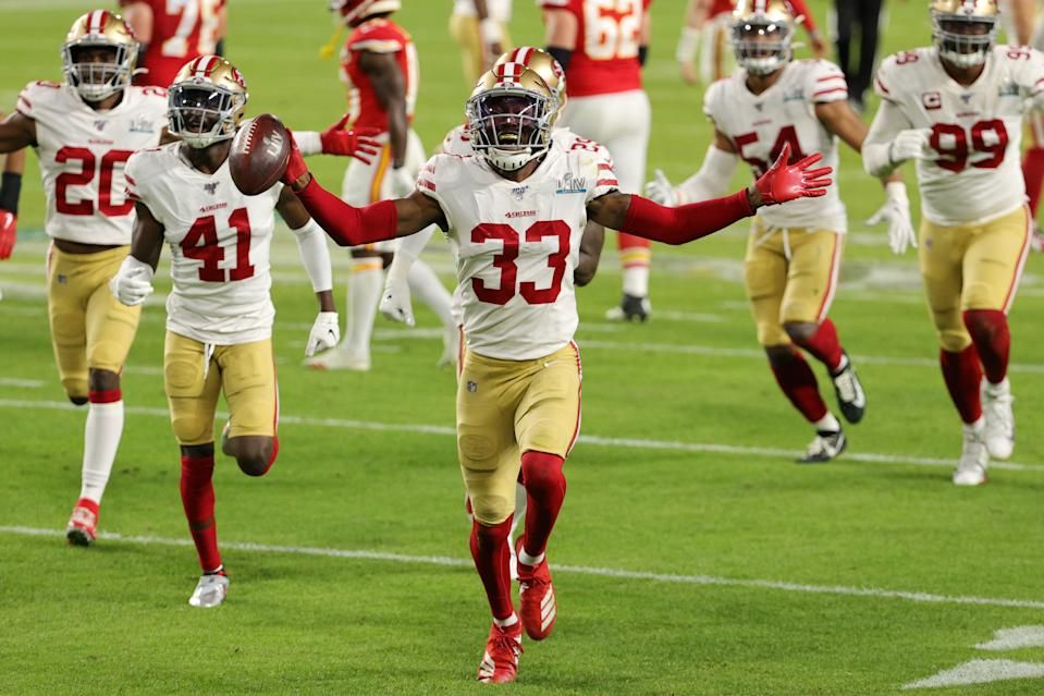 MIAMI, FLORIDA - FEBRUARY 02: Tarvarius Moore #33 of the San Francisco 49ers celebrates after intercepting a pass by Patrick Mahomes #15 of the Kansas City Chiefs (not pictured) during the third quarter in Super Bowl LIV at Hard Rock Stadium on February 02, 2020 in Miami, Florida. (Photo by Sam Greenwood/Getty Images)