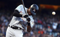 Miami Marlins' Lewis Brinson is hit by a pitch thrown by San Francisco Giants' Dereck Rodriguez during the second inning of a baseball game Tuesday, June 19, 2018, in San Francisco. (AP Photo/Ben Margot)