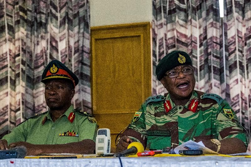 Zimbabwe Army chief Constantino Chiwenga (right) addresses a media conference in Harare on November 13, 2017 (AFP Photo/Jekesai NJIKIZANA)