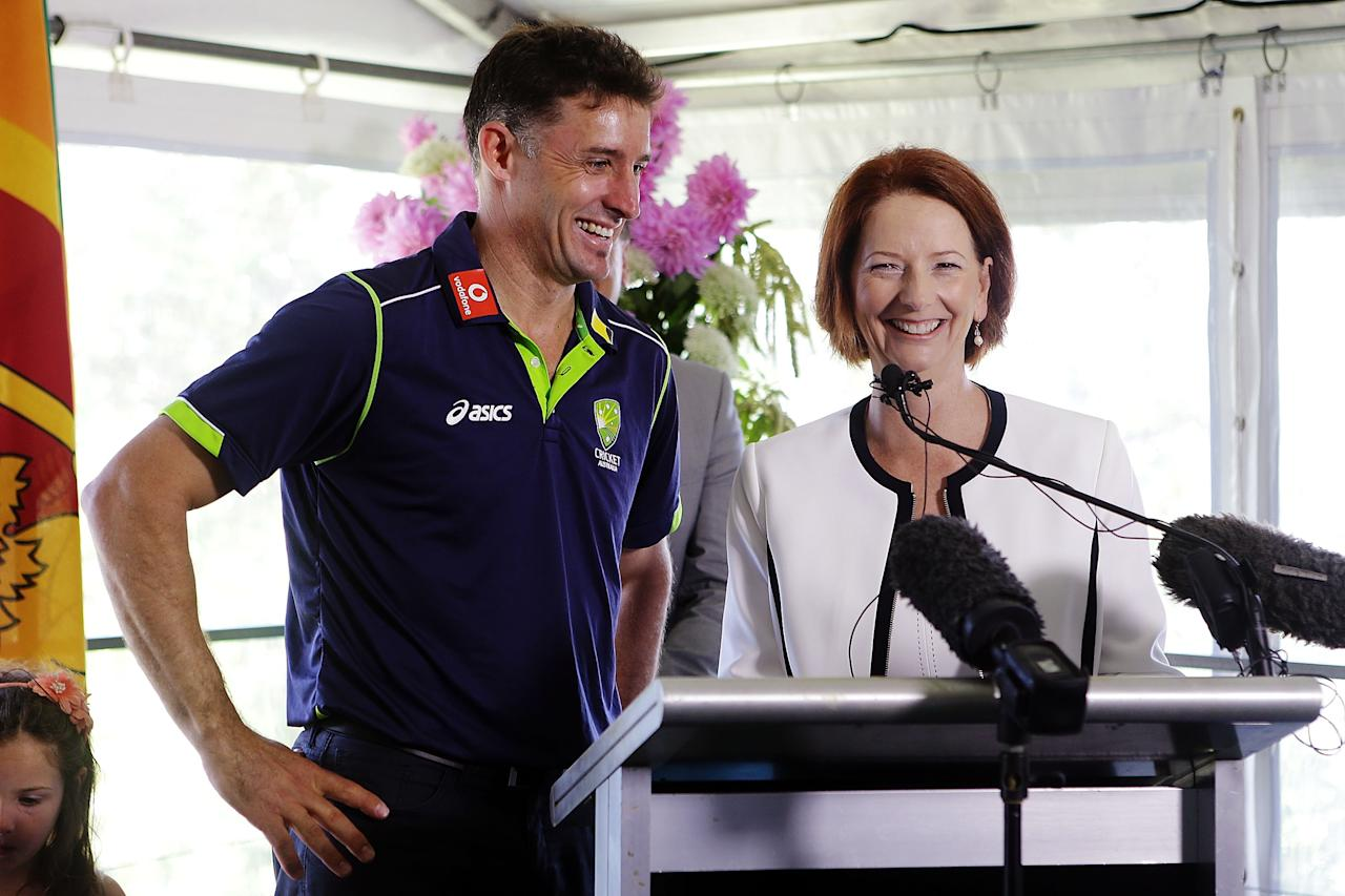 SYDNEY, AUSTRALIA - JANUARY 01:  Australian Prime Minister, Julia Gillard shares a joke with Michael Hussey of Australia during a function at Kirribilli House on January 1, 2013 in Sydney, Australia.  (Photo by Brendon Thorne/Getty Images)