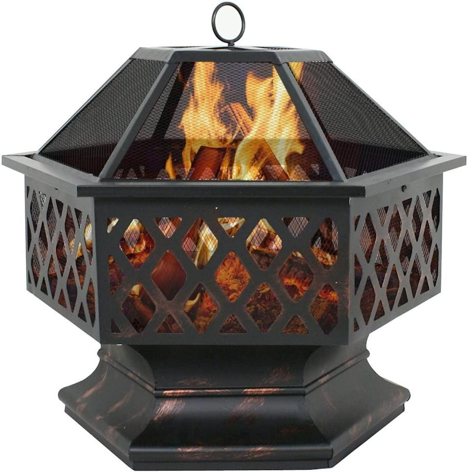 <p>Complete with a deep black finish, this <span>Outdoor Wood-Burning Fireplace</span> ($86) will heat up your backyard decor.</p>