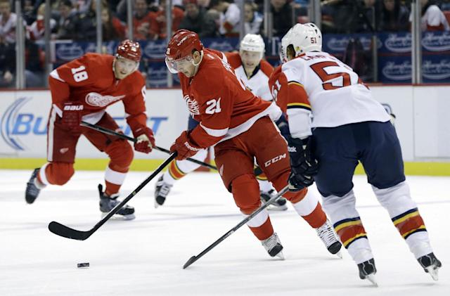 Detroit Red Wings left wing Tomas Tatar (21), of Czech Republic, controls the puck in front of Florida Panthers defenseman Brian Campbell (51) during the first period of an NHL hockey game in Detroit, Saturday, Dec. 7, 2013. (AP Photo/Carlos Osorio)