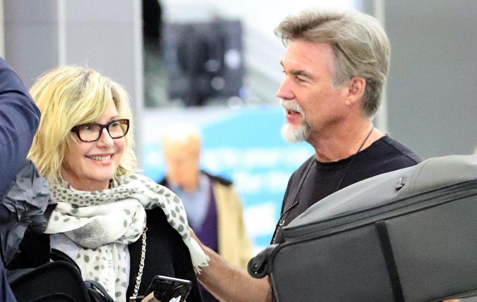 The 68-year-old looked happy to have touched down in Melbourne with her husband John. Source: Diimex
