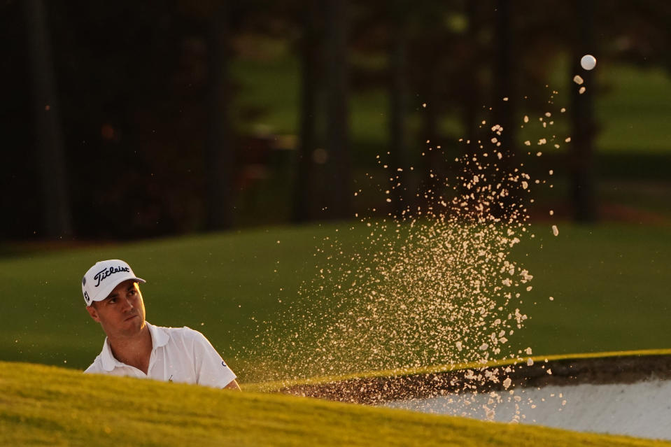 Justin Thomas watches his shot out of a bunker on the 18th hole during the third round of the Masters golf tournament Saturday, Nov. 14, 2020, in Augusta, Ga. (AP Photo/Matt Slocum)