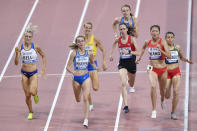 Alexandra Bell, of Great Britain, Natalіya Prishchepa, of Ukraine, Wang Chunyu, of China, and Malika Akkaoui, of Morocco, front row from left, compete during the women's 800 meters heats during the World Athletics Championships Friday, Sept. 27, 2019, in Doha, Qatar. (AP Photo/Martin Meissner)
