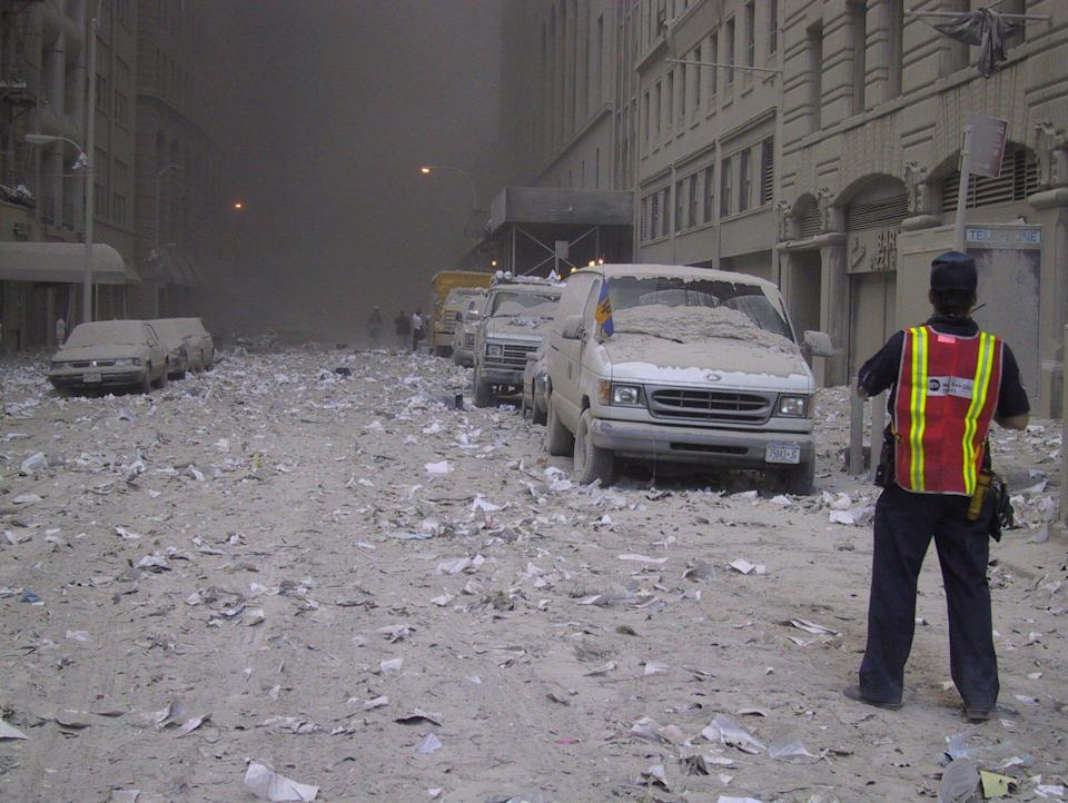 <p>Ash covers a street in downtown New York City after the collapse of the World Trade Center following a terrorist attack on Sept. 11, 2001. (Photo: Bernadette Tuazon/AP) </p>