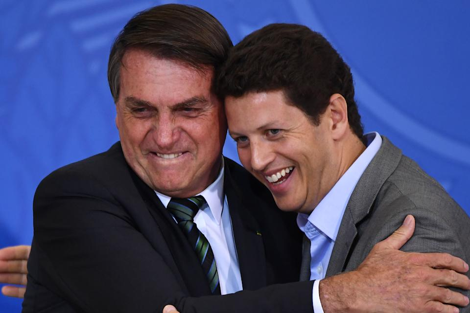Brazilian President Jair Bolsonaro (L) and his Environment Minister Ricardo Salles are seen during the Launch of the