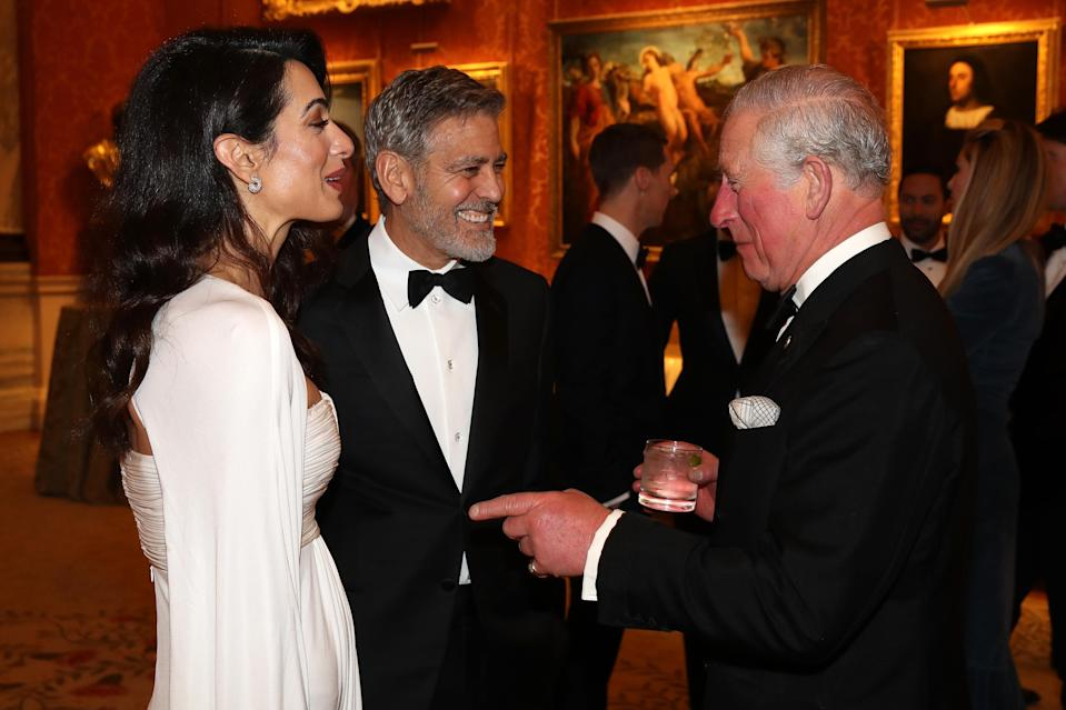 Amal and George Clooney meet Charles at a Buckingham Palace dinner [Photo: Getty]
