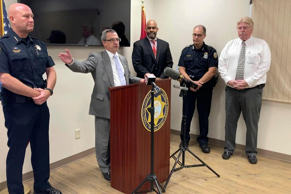 Hamilton County District Attorney Neal Pinkston, centre, speaks at a news conference, Wednesday, June 9, 2021, in Chattanooga, Tennessee (AP)