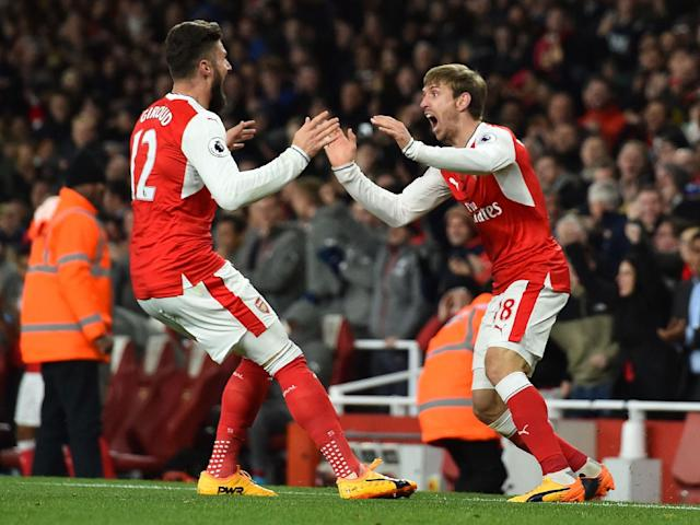 Monreal celebrates his late goal for the Gunners: Getty