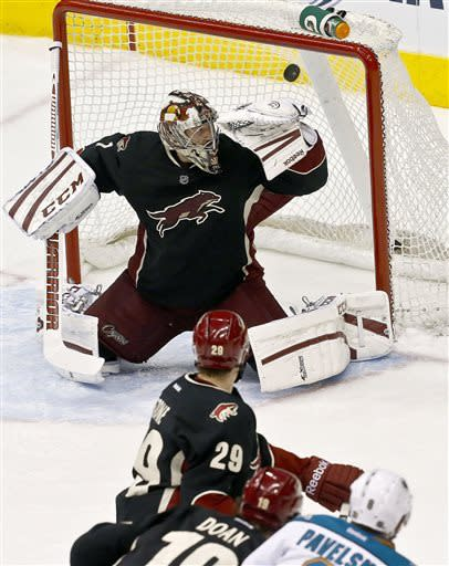 Phoenix Coyotes' Jason LaBarbera, top, gives up a goal to San Jose Sharks' Joe Pavelski (8) as Coyotes' Shane Doan (19) and Michael Stone (29) look on in the second period during an NHL hockey game, on Monday, April 15, 2013 in Glendale, Ariz. (AP Photo/Ross D. Franklin)