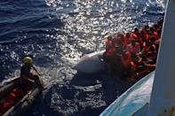 Miguel Duarte carries out a rescue operation from the Iuventa ship on the Mediterranean Sea