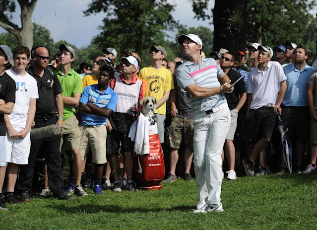 Rory McIlroy, of Northern Ireland, watches his shot from the rough on the eighth hole of the final round of the Bridgestone Invitational golf tournament, Sunday, Aug. 3, 2014, in Akron, Ohio. (AP Photo/Phil Long)