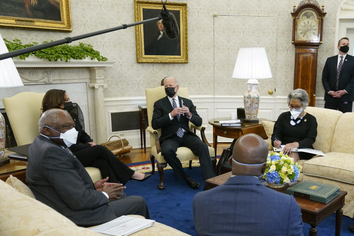 President Joe Biden speaks as he and Vice President Kamala Harris meet with members of the Congressional Black Caucus in the Oval Office of the White House, Tuesday, April 13, 2021, in Washington. Sitting are House Majority Whip James Clyburn, of S.C., from left, Sen. Raphael Warnock, D-Ga., and Rep. Joyce Beatty, D-Ohio. (AP Photo/Patrick Semansky)