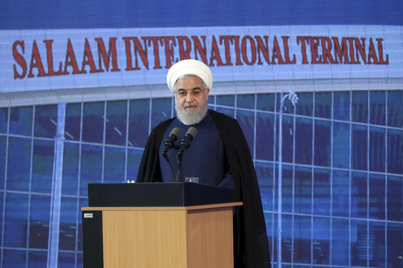 In this photo released by the official website of the office of the Iranian Presidency, Iranian President Hassan Rouhani speaks in a ceremony at Imam Khomeini International Airport some 25 miles (40 kilometers) south of the capital Tehran, Iran, Tuesday, June 18, 2019. President Rouhani says his country is not seeking to wage war against any nation while at the same time stressing that it will withstand mounting U.S. pressure and emerge victorious. (Iranian Presidency Office via AP)