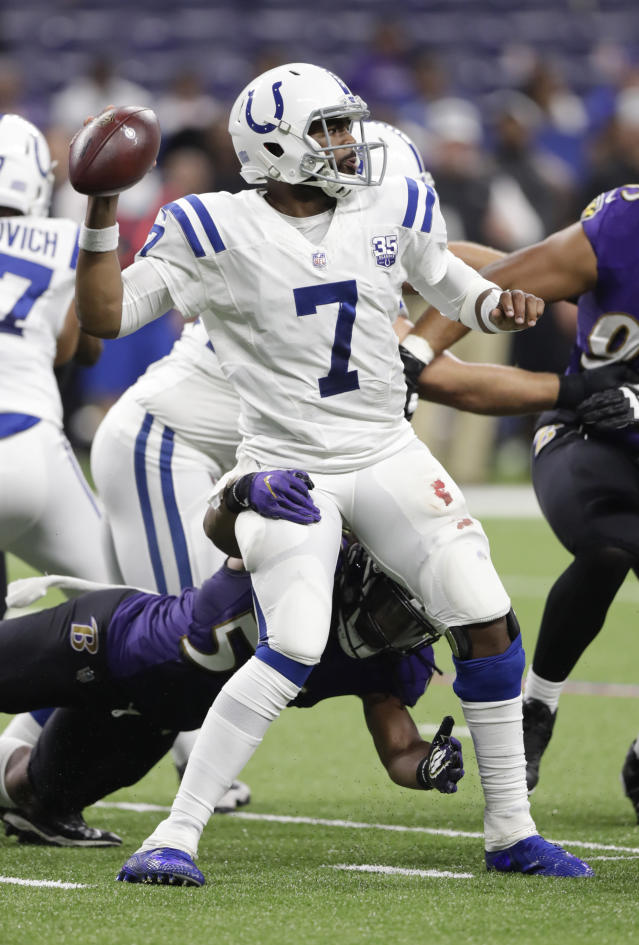 Indianapolis Colts quarterback Jacoby Brissett (7) throws a completion as he is hit by Baltimore Ravens linebacker Tim Williams (56) during the second half of an NFL preseason football game in Indianapolis, Monday, Aug. 20, 2018. (AP Photo/Michael Conroy)