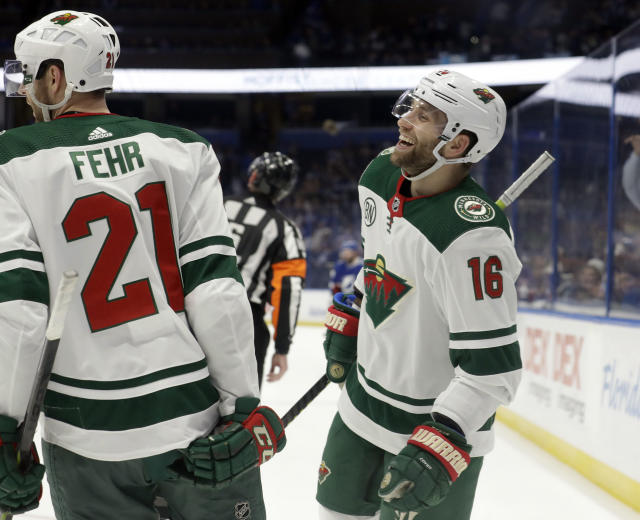 Minnesota Wild left wing Jason Zucker (16) celebrates his goal against the Tampa Bay Lightning with center Eric Fehr (21) during the third period of an NHL hockey game Thursday, March 7, 2019, in Tampa, Fla. (AP Photo/Chris O'Meara)