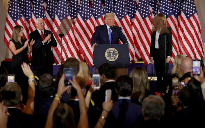 President Donald Trump speaks on election night in the East Room of the White House as First Lady Melania Trump, Vice President Mike Pence and Karen Pence look on - Getty Images North America