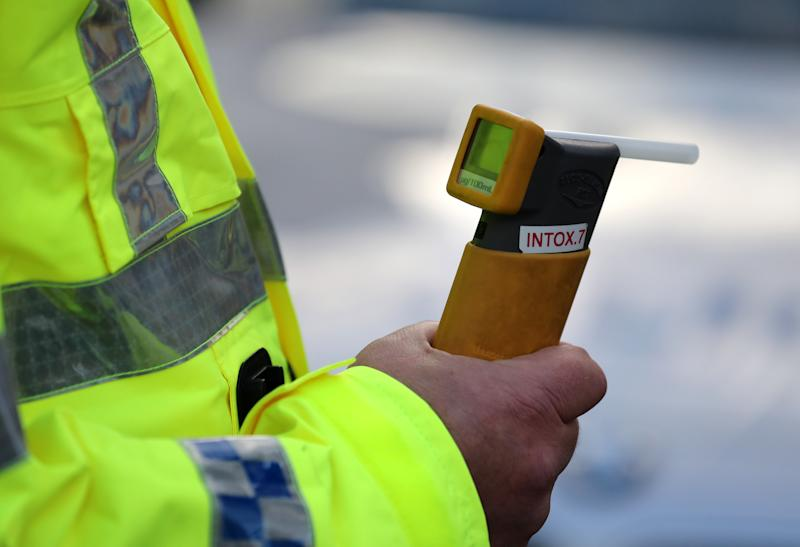 File photo dated 01/12/16 of a breathalyser held by a Police Officer, as the number of people killed in drink-drive crashes on Britain's roads has reached an eight-year high.