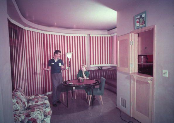 <p>Actors Tony Curtis and Janet Leigh weren't afraid of color in their home. Case in point: The red and white striped curtains in their at-home poker room. </p>