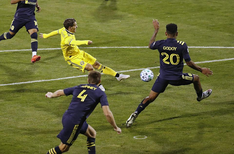 Columbus Crew SC forward Pedro Santos (7) scores a goal against Nashville SC midfielder Anibal Godoy (20) during the 2nd half of their MLS game at MAPFRE Stadium in Columbus, Ohio on September 19, 2020. [Kyle Robertson/Dispatch]