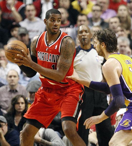 Portland Trail Blazers forward LaMarcus Aldridge, left, looks to pass against Los Angeles Lakers forward Pau Gasol, from Spain, during the first quarter of an NBA basketball game in Portland, Ore., Wednesday, Oct. 31, 2012. (AP Photo/Don Ryan)
