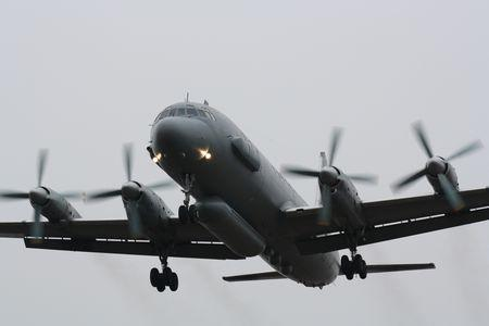 FILE PHOTO: A Russian Il-20 reconnaissance aircraft takes off from Central military airport in Rostov-on-Don, Russia December 14, 2010. REUTERS/Sergey Pivovarov