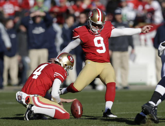 San Francisco 49ers kicker Phil Dawson (9) boots a field goal as Andy Lee, left, holds the ball in the first half of an NFL football game against the Seattle Seahawks, Sunday, Dec. 8, 2013, in San Francisco. (AP Photo/Marcio Jose Sanchez)