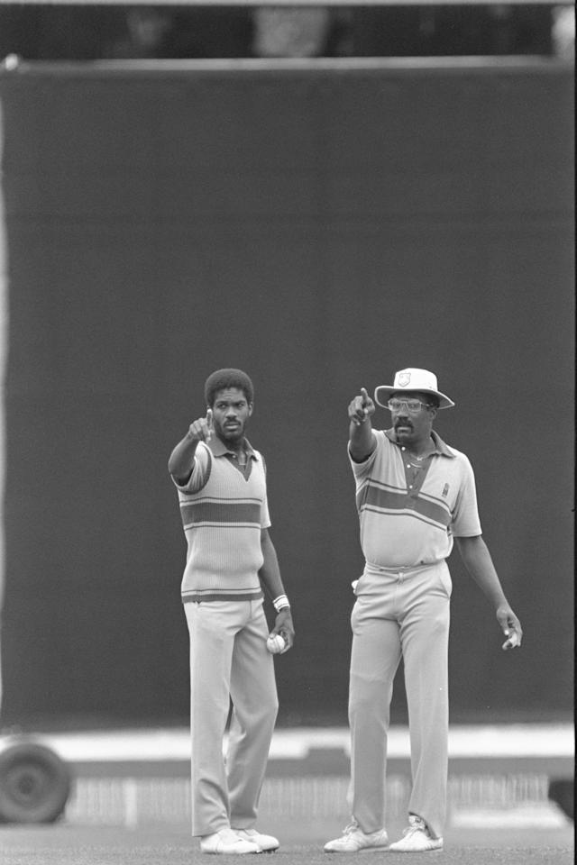 Feb 1985:  Michael Holding and Clive Lloyd (right) of the West Indies set the field during the Benson and Hedges World Series Finals. Mandatory Credit:  Adrian Murrell/Allsport UK