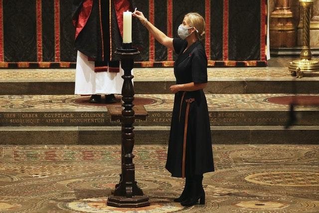 The Countess of Wessex lights a candle during the service. Jonathan Brady