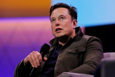FILE PHOTO - SpaceX owner and Tesla CEO Elon Musk speaks during a conversation with legendary game designer Todd Howard at the E3 gaming convention in Los Angeles
