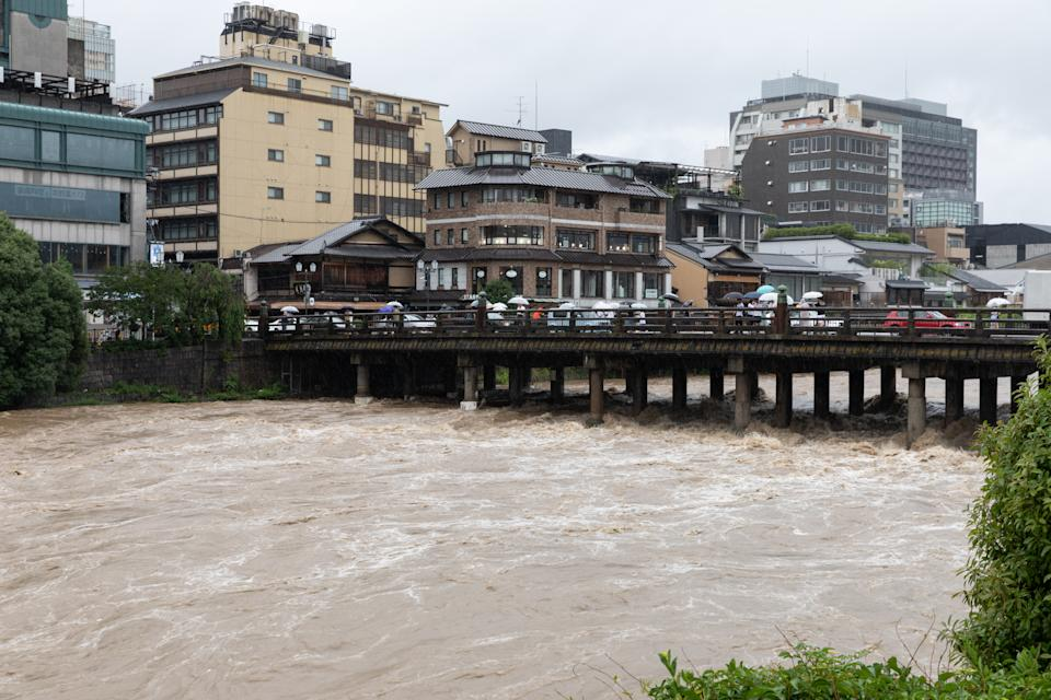 The country has been hit by extremely high temperatures over the past two years – the mercury rose to a record 41.1 degrees Celsius in August, this year, matching the highest recorded temperature ever, at Kumagaya, a city near Tokyo, in 2018. <br><br>Record rains in July 2018 brought landslides and floods to the western part of the country, killing 200 people. This was followed by an intense heatwave, post which, in September, the country was hit with an earthquake of the magnitude 6.7. <br><br>In 2018, extreme weather conditions caused a total of 1,282 deaths, losses of USD 35,839 million, translating to losses of 0.64 per unit of GDP. <br><br><em><strong>Image:</strong></em> Torrential rain in Kyoto, July 2018