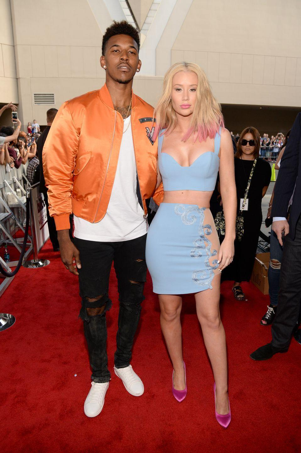 "<p>Iggy Azalea was in love with Lakers guard Nick Young, but the relationship didn't end well. The couple started seeing each other in 2014, which led to <a href=""https://www.usmagazine.com/celebrity-news/news/iggy-azalea-gets-engaged-to-nick-young-video-ring-pictures-201526/"" rel=""nofollow noopener"" target=""_blank"" data-ylk=""slk:their engagement in 2015"" class=""link rapid-noclick-resp"">their engagement in 2015</a>. In 2016, Iggy broke it off with her fiancé after<a href=""https://www.usmagazine.com/celebrity-news/news/iggy-azalea-and-nick-young-split-their-relationship-timeline-w210627/"" rel=""nofollow noopener"" target=""_blank"" data-ylk=""slk:he admitted to cheating"" class=""link rapid-noclick-resp""> he admitted to cheating</a>.</p>"