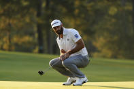 Dustin Johnson reacts after missing a birdie putt on the 17th green during the third round of the Masters golf tournament Saturday, Nov. 14, 2020, in Augusta, Ga. (AP Photo/Matt Slocum)