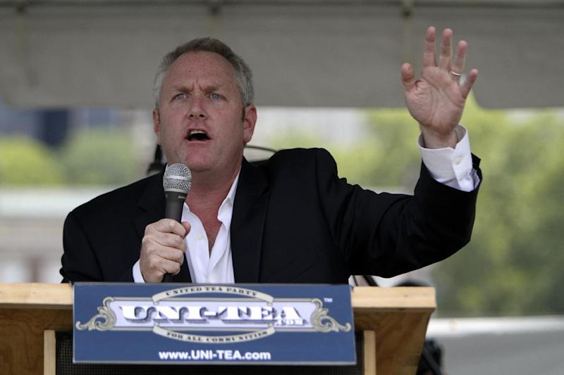 "FILE - In a Saturday July 31, 2010 file photo, conservative media publisher and activist Andrew Breitbart speaks to the audience at the ""Uni-Tea"" Tea Party rally at Independence Mall in Philadelphia. Breitbart, who was behind investigations that led to the resignations of former Rep. Anthony Weiner and former Agriculture Department official Shirley Sherrod, died Thursday, March 1, 2012 in Los Angeles. He was 43. (AP Photo/ Joseph Kaczmarek, File)"
