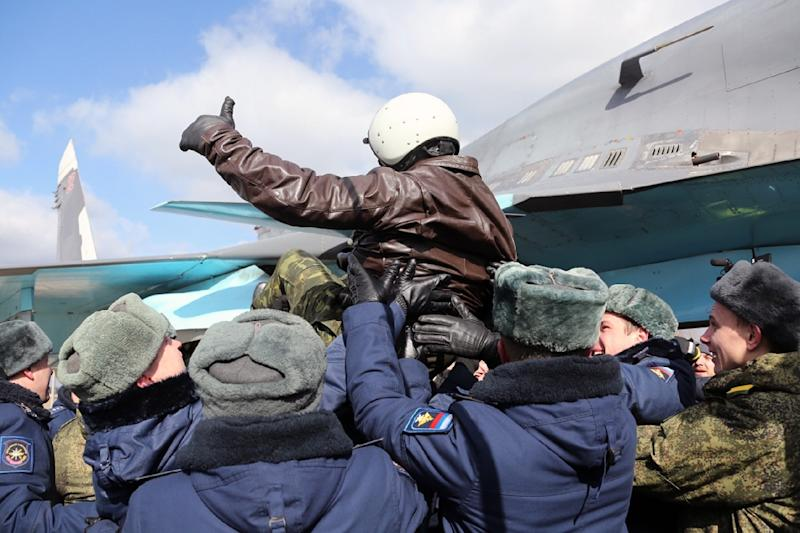 A Russian pilot was given a hero's-welcome as he returned from Syria for a ceremony in Voronezhto, on March 15, 2016 (AFP Photo/Olga Balashova)