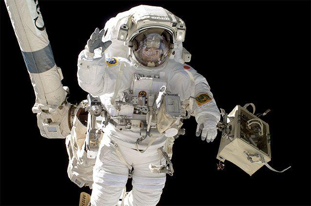 An astronaut on a space walk outside the International Space Station.  NASA / Getty Images