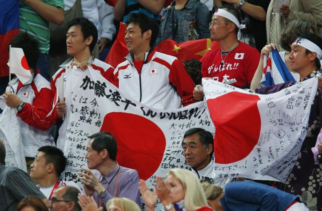 Japan fans hold a large flag during the men's gymnastics team final in the North Greenwich Arena at the London 2012 Olympic Games July 30, 2012. REUTERS/Brian Snyder (BRITAIN - Tags: OLYMPICS SPORT GYMNASTICS)