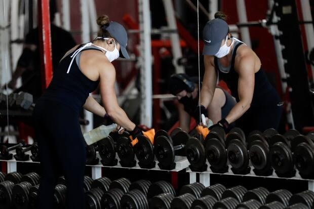 B.C.'s solicitor general has issued a ministerial order that will allow police to enforce the provincial health officer's mask guidelines in fitness studios. (AP - image credit)