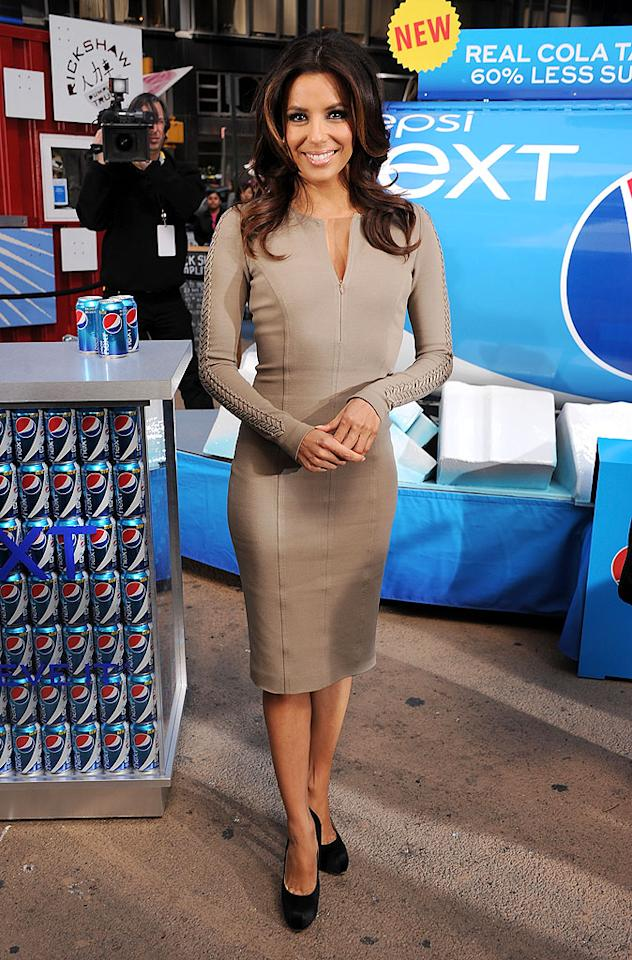 "Eva Longoria was all smiles as she hawked Pepsi's latest drink, Pepsi Next, in NYC's Times Square over the weekend. The pint-sized star -- whose show, ""Desperate Housewives,"" concludes this May -- kept covered up in a taupe Andrew Gn dress and black Brian Atwood pumps. (4/6/2012)"