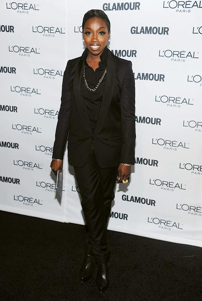 "Meanwhile, ""American Boy"" singer Estelle donned a boring black suit. Dimitrios Kambouris/<a href=""http://www.wireimage.com"" target=""new"">WireImage.com</a> - November 9, 2009"