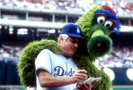 Tommy Lasorda of the Los Angeles Dodgers with the Phillie Fanatic during an MLB baseball game at Veterans Stadium circa 1981 in Philadelphia, Pennsylvania. (Photo by Focus on Sport/Getty Images)